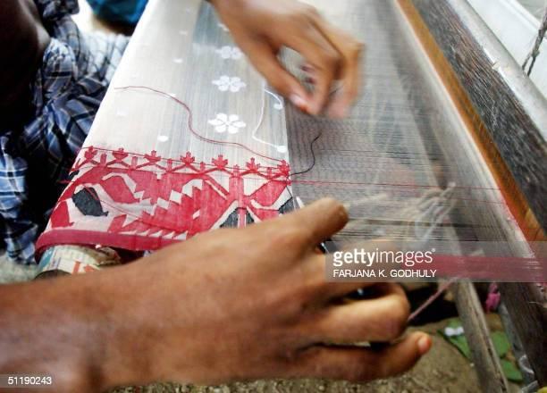 Bangladeshi weaver designs a Jamdani Sari in the village of Rupganj Thana on the outskirts of Dhaka 19 August 2004 Floods that submerged up to...