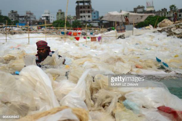 A Bangladeshi woman arranges plastic bags to dry and recycle in Dhaka on May 14 2018