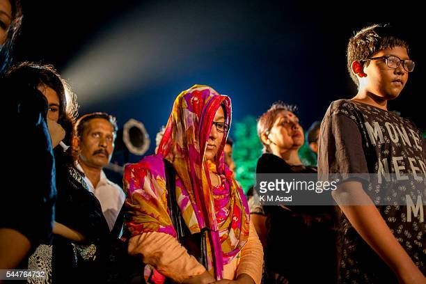 Bangladeshi Woman attends a candlelight tribute to the people who have been killed in a terrorists attack at the Holey Artisan Bakery in Dhaka...