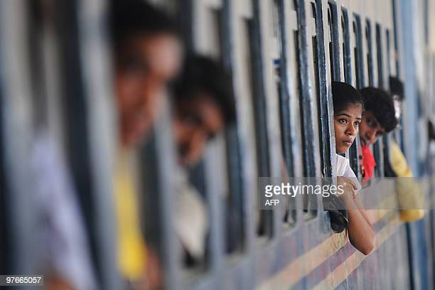 A Bangladeshi woman looks out of a train window at a railway station in Dhaka on June 17 2009 Bangladesh Railways has been running at a loss over the...