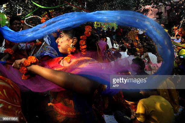 A Bangladeshi woman participates in a procession during the Boshonto Utshob festival in Dhaka on February 13 2010 The spring festival or Boshonto...
