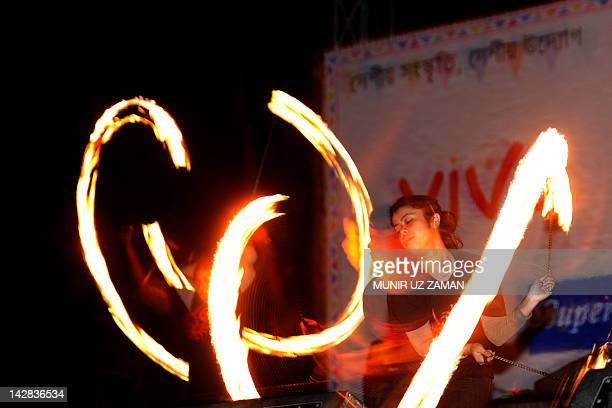 A Bangladeshi woman performs a fire dance on the day of the Chaitra Sangkranti in Dhaka on April 13 2012 Chaitra Sankranti is an ageold festival of...