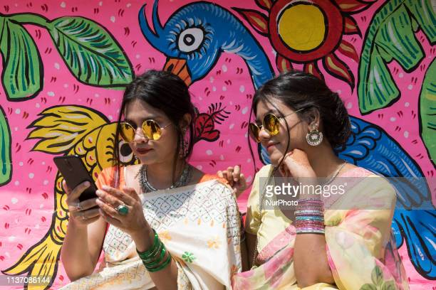 Bangladeshi woman pose for a portrait infront of wall paint to celebrate the first day of the Bengali New Year or Pohela Boishakh on April 14 2019 in...