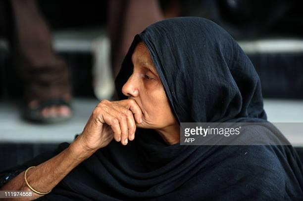 A Bangladeshi woman waits for news of a missing relative at the Bangaldesh Rifles heaquarters in Dhaka on March 1 2009 Bangladeshi police were...