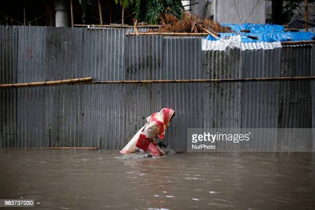 Residents of Dhaka city stuck in the flooded street in Dhaka Bangladesh on June 25 2018 Many major streets get flooded after heavy rainfalls in the...