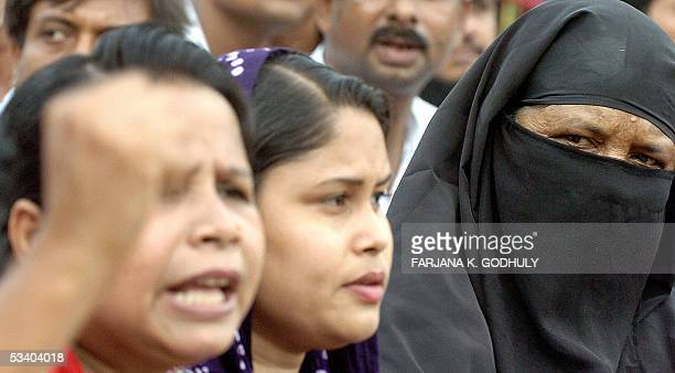 Bangladeshi woman wearing a veil takes part in an antibomb demonstration organized jointly by the Awami League and leftist parties in Dhaka 18 August...