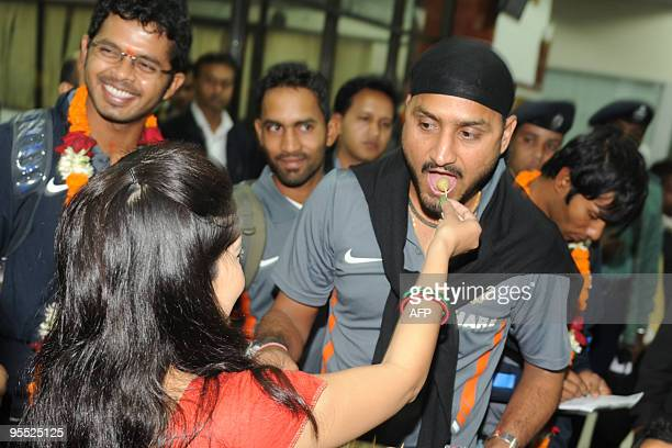 A Bangladeshi woman welcomes Indian cricketer Harbhajan Singh after arriving at the Zia International Airport in Dhaka on January 2 2010 The Indian...
