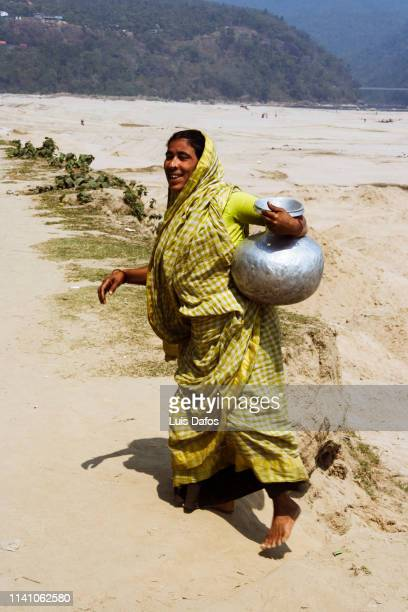 Bangladeshi woman with water pitcher