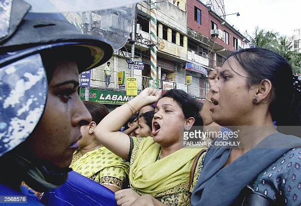 Bangladeshi women activists of the main opposition Awami League shout slogans in front of riot police 27 September 2003 during an antigovernment...