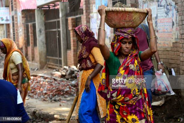 Bangladeshi women daily labor works in a road construction side in Dhaka Bangladesh on May 27 2019 Each woman labor earns 500 taka or 6 US Dollar par...