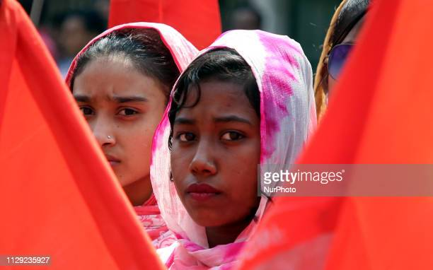 Bangladeshi women hold placards as they take part in a rally to mark International Women's Day in Dhaka, Bangladesh, on March 8, 2019. Thousands of...