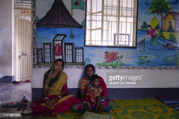 Bangladeshi women look on as they take shelter in a cyclone shelter in Khulna on May 4 as Cyclone Fani reached Bangladesh Cyclone Fani one of the...