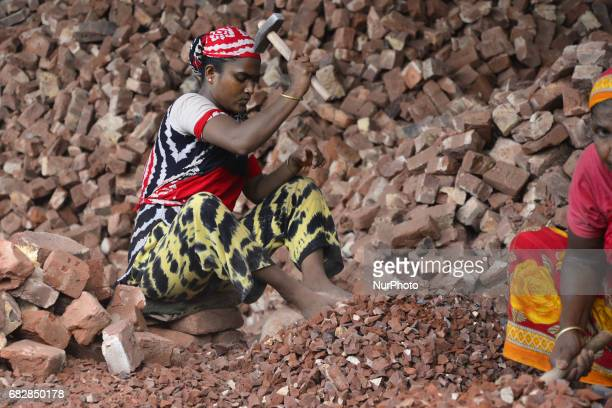 Bangladeshi women Men and Childs break bricks at Demra brick breaking yard in Dhaka Bangladesh On May 13 2017 With over half of the population living...
