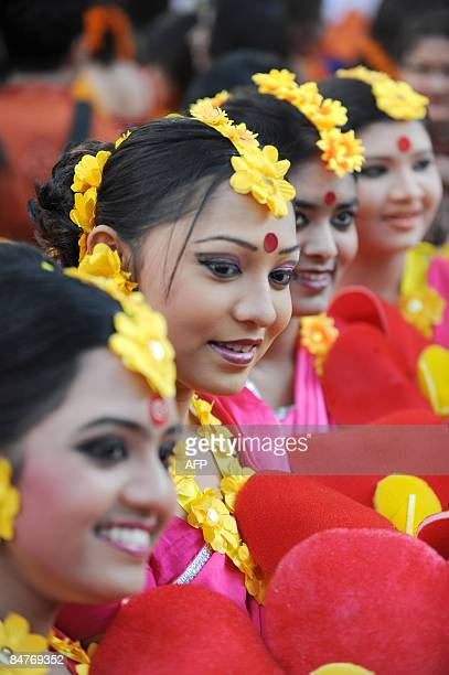 Bangladeshi women pose for photographs at they attend the Boshonto Utshob festival in Dhaka on February 13 2009 The spring festival of Boshonto...