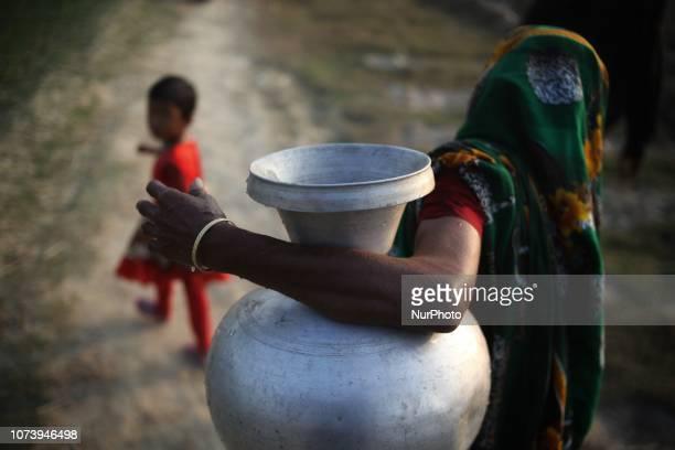 A bangladeshi women seen carrying drinking water Photo has taken on Friday 14 December 2018 from Goalandaghat Bangladesh