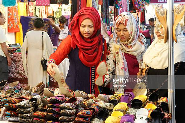 Bangladeshi women shoppers visit at a market during the holy month of Ramadan ahead of Eid AlFitr celebrations in Dhaka on June 16 2016 Muslims...