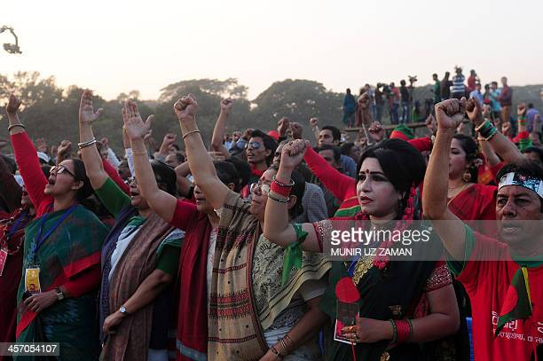 Bangladeshi women shout slogans as they gather at a rally to mark the country's Victory Day in Dhaka on December 16 2013 Bangladesh won independence...