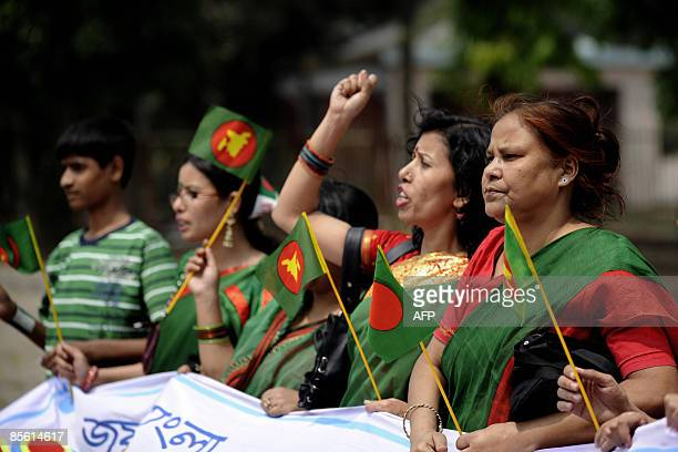 Bangladeshi women shout slogans as they pay their respects at the memorial for freedom fighters who gave their lives during the ninemonth war against...