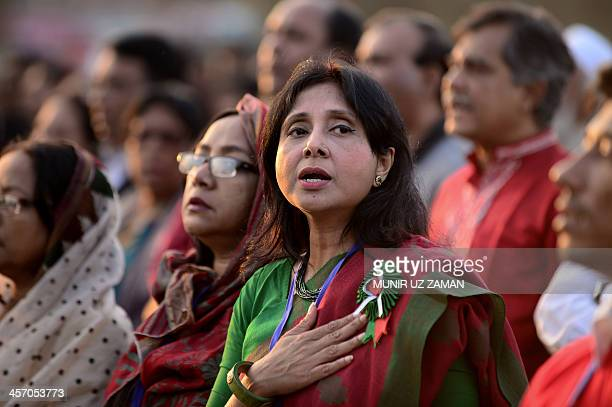 Bangladeshi women sing the national anthem at 431pm the exact moment when the Pakistan army surrendered on this day in 1971 as they gather at a rally...
