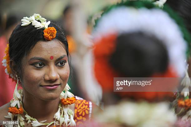 Bangladeshi women wearing traditional costumes participate in the Boshonto Utshob festival in Dhaka on February 13 2009 The spring festival of...