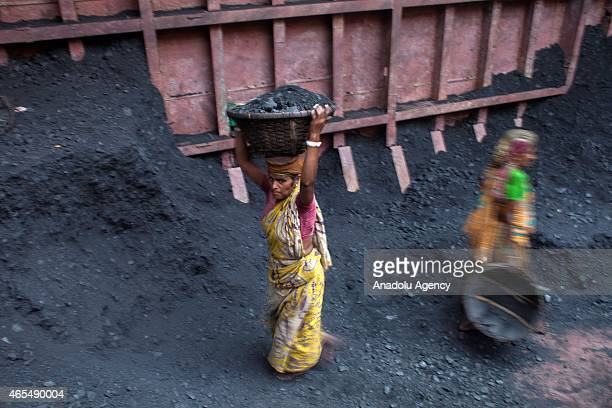 Bangladeshi women workers unload coal from a ship ahead of International Women's Day 2015 in Dhaka Bangladesh on March 7 2015