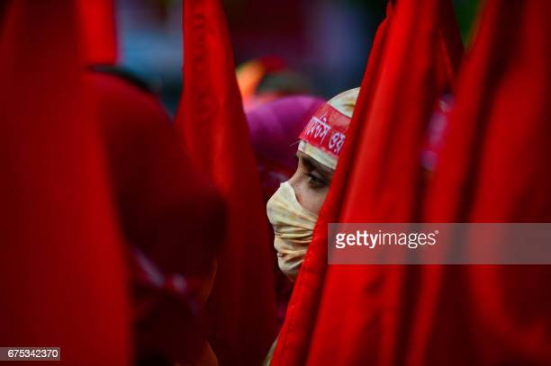 Bangladeshi worker looks on as she attends a procession to mark May Day or International Workers' Day in Dhaka on May 1 2017 Activists around the...