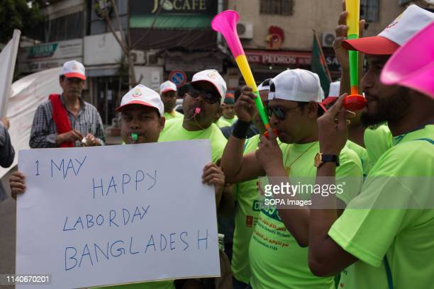 Bangladeshi worker seen holding a placard that says 1 may happy labor day Bangladesh during the protest May is International labour day also known as...