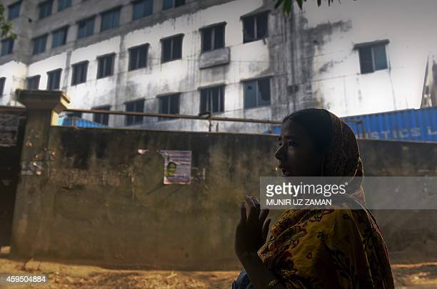 Bangladeshi worker who survived a fire at the Tazreen garment factory talks about her experience during a rally to mark the two-year anniversary of...