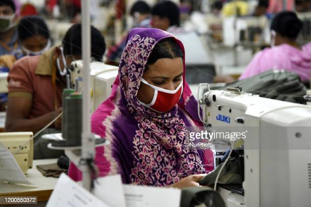 Bangladeshi worker works at a garment factory in Savar outskirts of Dhaka, Bangladesh, on February 13, 2020. The garment sector has provided...