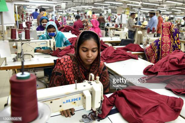 Bangladeshi worker works at a garment factory in Savar outskirts of Dhaka Bangladesh on February 13 2020 The garment sector has provided employment...