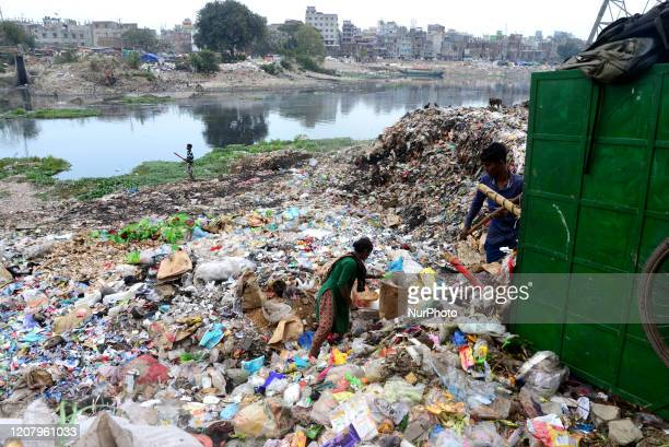 Bangladeshi workers dumping human waste in the polluted Buriganga River in Dhaka Bangladesh on March 22 2020 Bangladesh has been reportedly ranked...