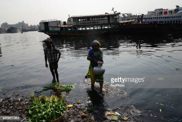 Bangladeshi workers making a small channel in the dry branch river of Buriganga river in Dhaka Bangladesh on March 21 2018 World Water Day is...