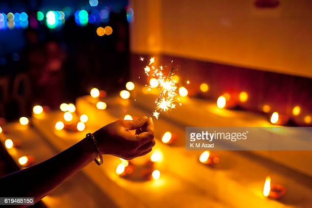 Bangladeshi young girl celebrates the Diwali festival or the 'festival of lights' at a temple in Dhaka The Diwali festival of lights symbolizes the...