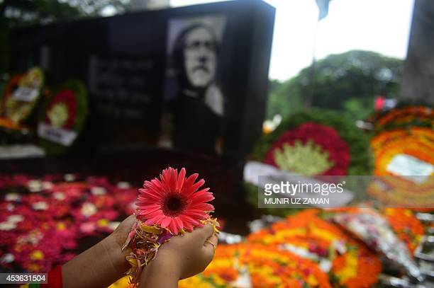 A Bangladeshi youth lays flowers at the Sheikh Mujibur Rahman Memorial in Dhaka on August 15 2014 Bangladesh's Sheikh Mujibur Rahman the country's...