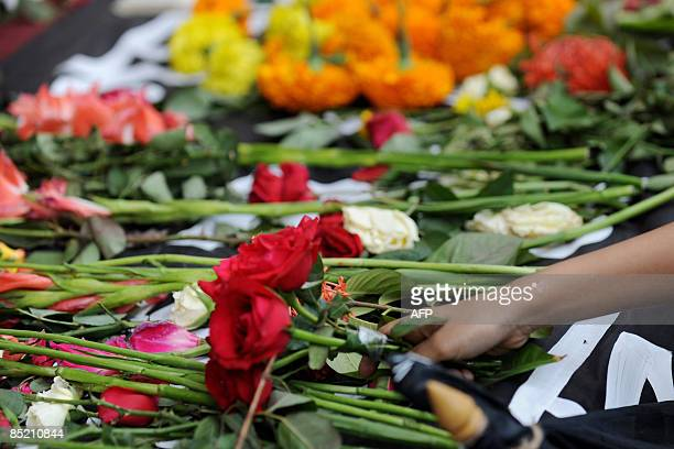 A Bangladeshi youth lays flowers in front of the Bangladesh Rifles headquarters in remembrance for those killed during the recent mutiny in Dhaka on...