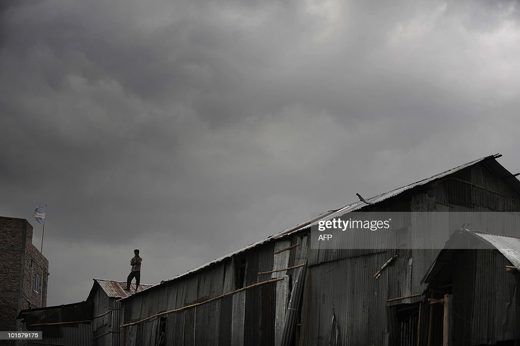 A Bangladeshi youth looks on after fire services end the rescue operation at a four-storey collapsed building in Dhaka on June 3, 2010.The death toll from the building collapse in the city two days ago rose to 25 on Thursday as the fire service decided to end its rescue operations claiming there were no more missing bodies.