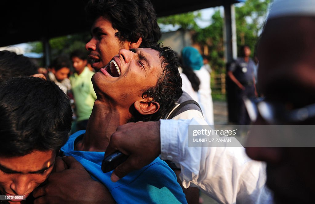 A Bangladeshi youth reacts after seeing his relatives dead body after a building collapse in Savar, on the outskirts of Dhaka, on April 24, 2013. An eight-storey building containing several garment factories collapsed in Bangladesh, killing at least 82 people and further highlighting safety problems in the clothing industry. Armed with concrete cutters and cranes, hundreds of fire service and army rescue workers struggled to find survivors in the mountain of concrete and mangled steel, which resembled the aftermath of an earthquake. AFP PHOTO/ Munir uz ZAMAN