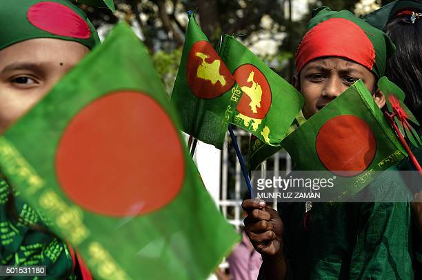 Bangladeshi youths are dressed in the colours of the national flag as they take part in a rally to mark the country's 44th Victory Day in Dhaka on...