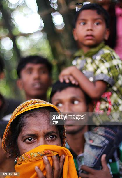 Bangladeshi Zulekha Begum waits to talk to police to try and get information regarding her younger sister who was killed in a garment factory that...