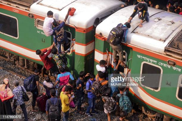 Bangladeshis cram onto a train as they travel back home to meet their families ahead of the Muslim festival of Eid alFitr in Dhaka on June 4 2019...