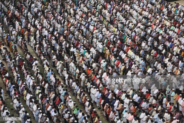 TOPSHOT Bangladeshis offer funeral prayer for Awami League leader Sheikh Fazlul Karim Selim's grandson Zayan Chowdhury who was killed in the series...