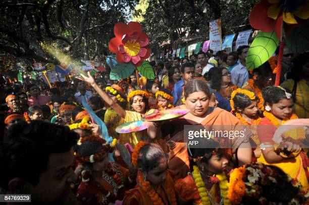 Bangladeshis throw coloured powder as they participate in a procession during the Boshonto Utshob festival in Dhaka on February 13 2009 The spring...