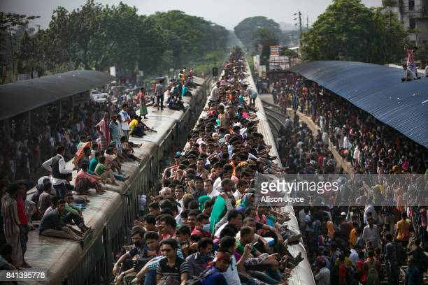 Bangladeshis travel by train to go home to their villages the day before Eid on September 1 2017 in Dhaka Bangladesh Muslims worldwide celebrate Eid...