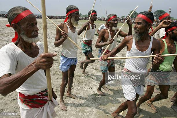 Bangladesh-media-agriculture-games,FEATURE by Helen Rowe Bangladeshi farmers prepare for a traditional stick fight during the television gameshow...