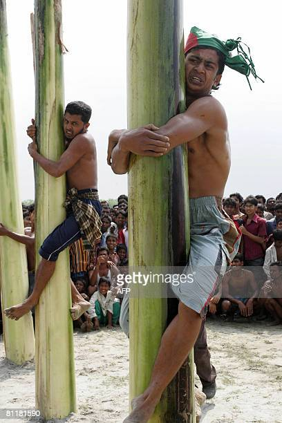 Bangladesh-media-agriculture-games,FEATURE by Helen Rowe Bangladeshi farmers grip the oiled trunks of banana trees during the television game show...