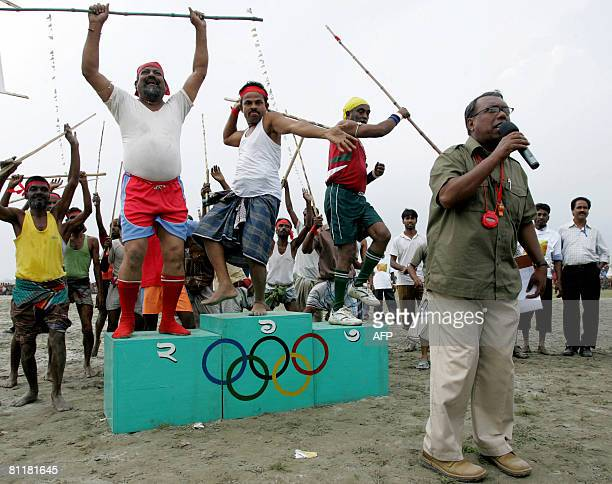 Bangladesh-media-agriculture-games,FEATURE by Helen Rowe Bangladeshi contestants celebrate their prowess in stick fighting during the television game...