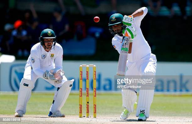 Bangladesh's batsman Mahmudallah is watched by South Africa's wicketkeeper Quinton de Kock as he plays a shot during the third day of the second Test...