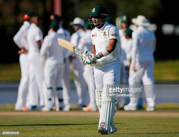 Bangladesh's batsman Sabbir Rahman reacts as he walks back to the pavilion after his dismissal by South Africa's bowler Kagiso Rabada during the...