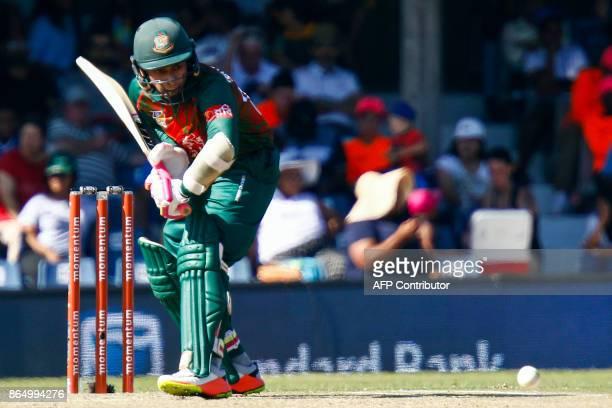 Bangladesh's batsman Shakib Al Hasan plays a shot during the 3rd ODI match at the Buffalo Park in East London on October 22 2017 / AFP PHOTO /...