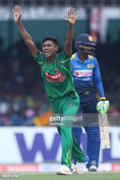Bangladesh's bowler Mustafizur Rahman unsuccessfully appeals for the wicket of Sri Lanka's Upul Tharanga during their third oneday international...